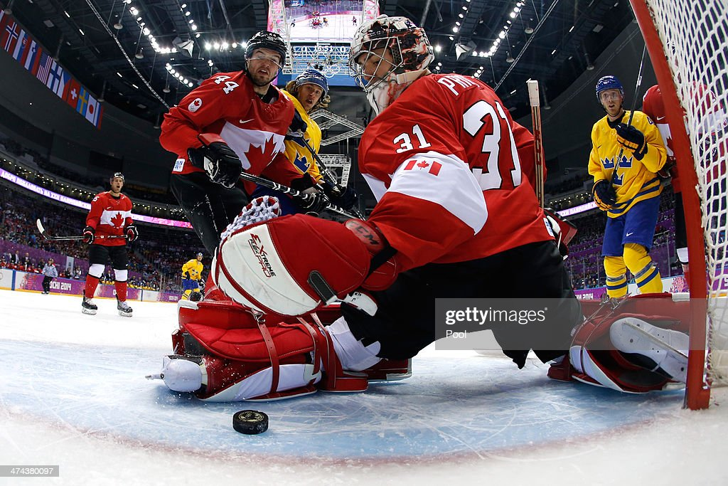 Goalie Carey Price #31 of Canada falls on the puck after making a save in the first period during the Men's Ice Hockey Bronze Medal Game against Sweden on Day 15 of the 2014 Sochi Winter Olympics at Bolshoy Ice Dome on February 22, 2014 in Sochi, Russia.