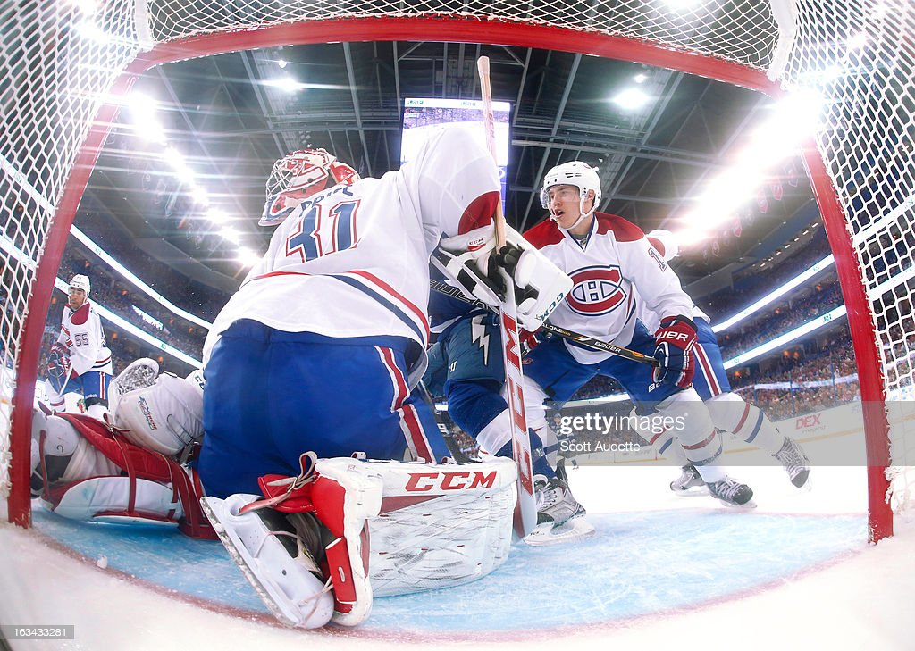 Goalie <a gi-track='captionPersonalityLinkClicked' href=/galleries/search?phrase=Carey+Price&family=editorial&specificpeople=2222083 ng-click='$event.stopPropagation()'>Carey Price</a> #31 of the Montreal Canadiens blocks while his mask is turned around during the second period of the game against the Tampa Bay Lightning at the Tampa Bay Times Forum on March 9, 2013 in Tampa, Florida.