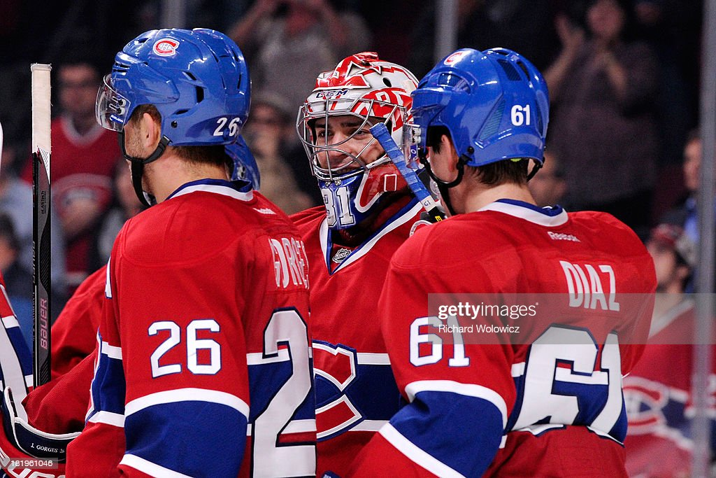 Goalie <a gi-track='captionPersonalityLinkClicked' href=/galleries/search?phrase=Carey+Price&family=editorial&specificpeople=2222083 ng-click='$event.stopPropagation()'>Carey Price</a> #31 of the Montreal Canadiens celebrates with teammates after defeating the Ottawa Senators in an NHL preseason game at the Bell Centre on September 26, 2013 in Montreal, Quebec, Canada. The Canadiens defeated the Senators 3-1.