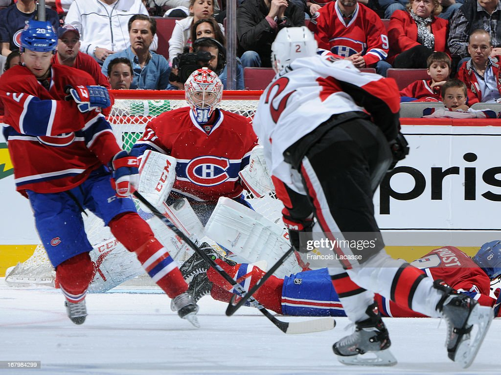 Goalie <a gi-track='captionPersonalityLinkClicked' href=/galleries/search?phrase=Carey+Price&family=editorial&specificpeople=2222083 ng-click='$event.stopPropagation()'>Carey Price</a> #31 of the Montreal Canadiens defends against a shot by <a gi-track='captionPersonalityLinkClicked' href=/galleries/search?phrase=Jared+Cowen&family=editorial&specificpeople=4594191 ng-click='$event.stopPropagation()'>Jared Cowen</a> #2 of the Ottawa Senators in Game Two of the Eastern Conference Quarterfinals during the 2013 NHL Stanley Cup Playoffs at the Bell Centre on May 3, 2013 in Montreal, Quebec, Canada.