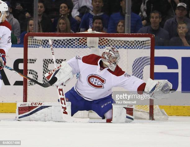 Goalie Carey Price of the Montreal Canadiens makes a glove save in the first period of an NHL hockey game against the New York Rangers at Madison...