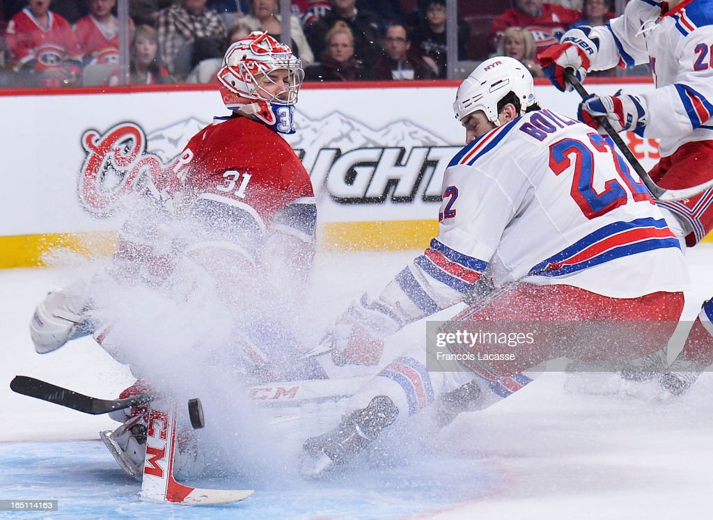 Goalie <a gi-track='captionPersonalityLinkClicked' href=/galleries/search?phrase=Carey+Price&family=editorial&specificpeople=2222083 ng-click='$event.stopPropagation()'>Carey Price</a> #31 of the Montreal Canadiens makes a pad save against Brian Boyle #22 of the New York Rangers during the NHL game on March 30, 2013 at the Bell Centre in Montreal, Quebec, Canada.