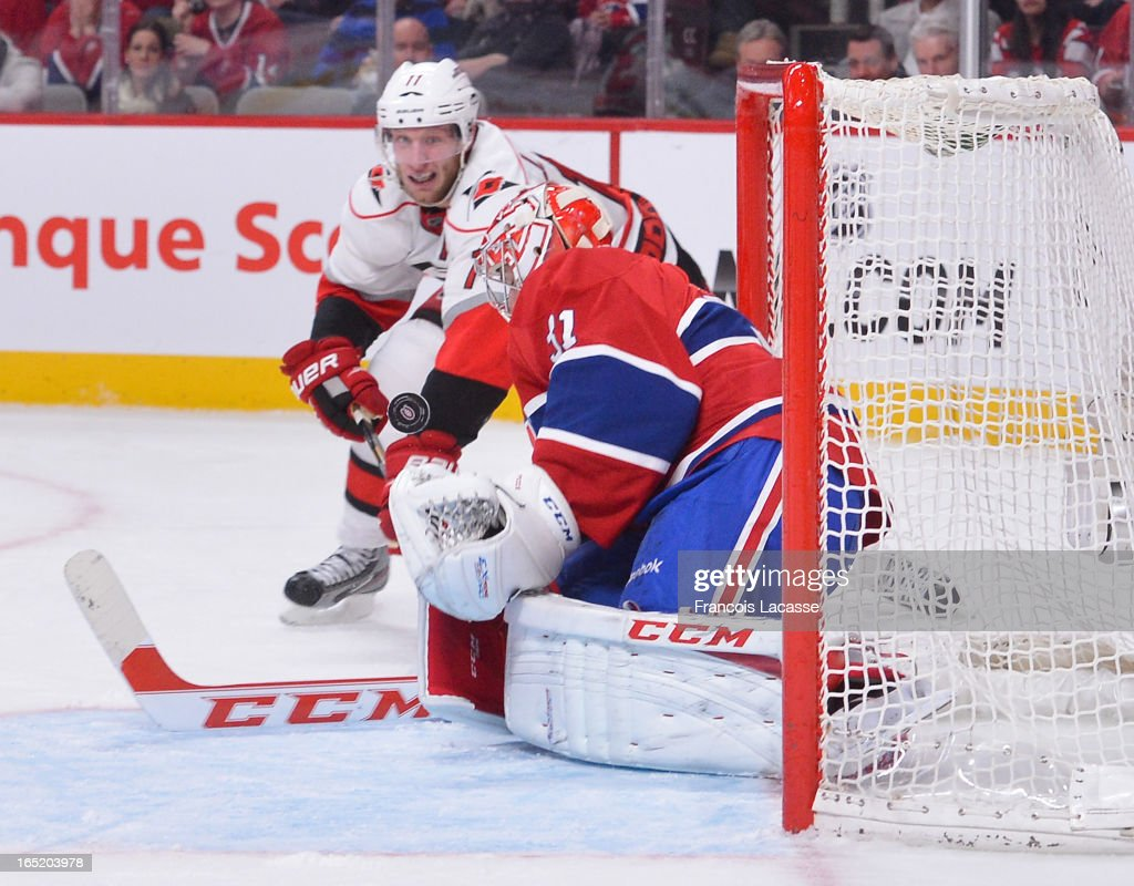 Goalie <a gi-track='captionPersonalityLinkClicked' href=/galleries/search?phrase=Carey+Price&family=editorial&specificpeople=2222083 ng-click='$event.stopPropagation()'>Carey Price</a> #31 of the Montreal Canadiens makes a save against <a gi-track='captionPersonalityLinkClicked' href=/galleries/search?phrase=Jordan+Staal&family=editorial&specificpeople=533044 ng-click='$event.stopPropagation()'>Jordan Staal</a> #11 of the Carolina Hurricanes during the NHL game on April 1, 2013 at the Bell Centre in Montreal, Quebec, Canada.
