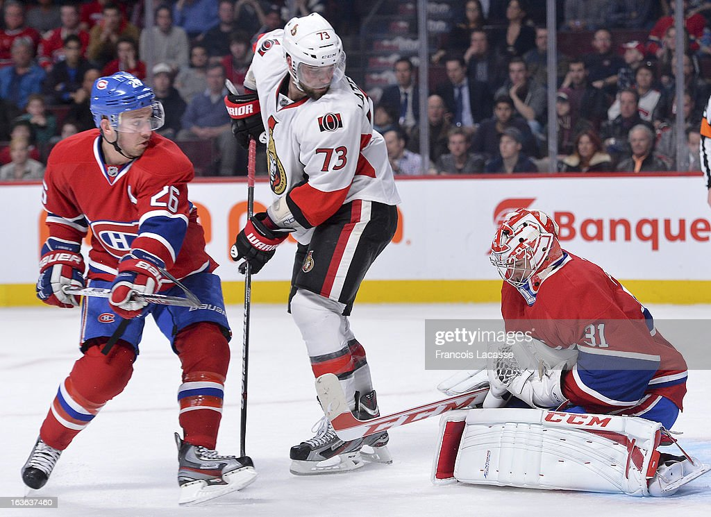 Goalie <a gi-track='captionPersonalityLinkClicked' href=/galleries/search?phrase=Carey+Price&family=editorial&specificpeople=2222083 ng-click='$event.stopPropagation()'>Carey Price</a> #31 of the Montreal Canadiens makes a save as teammate <a gi-track='captionPersonalityLinkClicked' href=/galleries/search?phrase=Josh+Gorges&family=editorial&specificpeople=550446 ng-click='$event.stopPropagation()'>Josh Gorges</a> #26 and <a gi-track='captionPersonalityLinkClicked' href=/galleries/search?phrase=Guillaume+Latendresse&family=editorial&specificpeople=848999 ng-click='$event.stopPropagation()'>Guillaume Latendresse</a> #73 of the Ottawa Senators look for a rebound during the NHL game on March 13, 2013 at the Bell Centre in Montreal, Quebec, Canada.