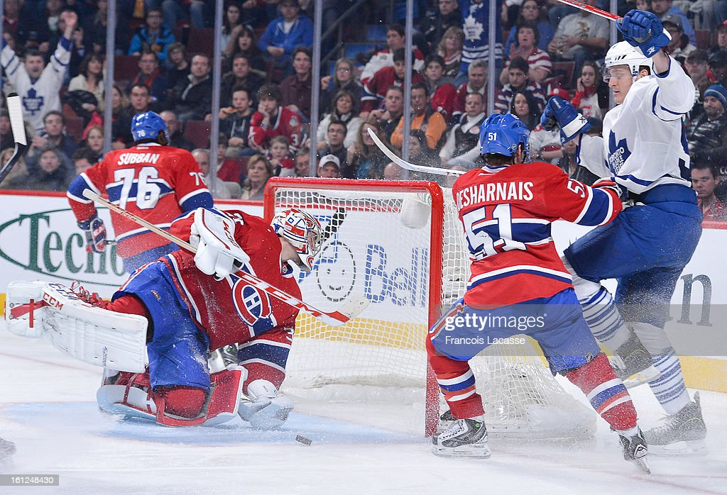 Goalie <a gi-track='captionPersonalityLinkClicked' href=/galleries/search?phrase=Carey+Price&family=editorial&specificpeople=2222083 ng-click='$event.stopPropagation()'>Carey Price</a> #31 of the Montreal Canadiens reacts to a goal by the Toronto Maple Leafs during the NHL game on February 9, 2013 at the Bell Centre in Montreal, Quebec, Canada.