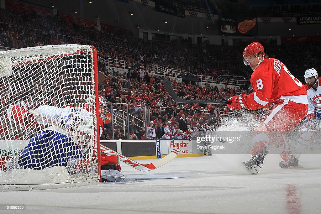 Goalie <a gi-track='captionPersonalityLinkClicked' href=/galleries/search?phrase=Carey+Price&family=editorial&specificpeople=2222083 ng-click='$event.stopPropagation()'>Carey Price</a> #31 of the Montreal Canadiens slides across the net as <a gi-track='captionPersonalityLinkClicked' href=/galleries/search?phrase=Justin+Abdelkader&family=editorial&specificpeople=2271858 ng-click='$event.stopPropagation()'>Justin Abdelkader</a> #8 of the Detroit Red Wings misses the net with a shot during an NHL game on January 24, 2014 at Joe Louis Arena in Detroit, Michigan. Detroit defeated Montreal 4-1