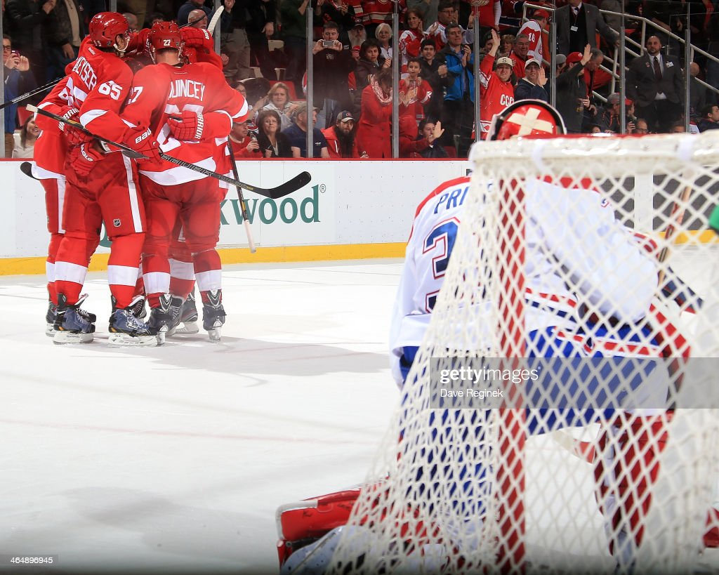 Goalie <a gi-track='captionPersonalityLinkClicked' href=/galleries/search?phrase=Carey+Price&family=editorial&specificpeople=2222083 ng-click='$event.stopPropagation()'>Carey Price</a> #31 of the Montreal Canadiens watches as Danny DeKeyser #65, <a gi-track='captionPersonalityLinkClicked' href=/galleries/search?phrase=Kyle+Quincey&family=editorial&specificpeople=2234340 ng-click='$event.stopPropagation()'>Kyle Quincey</a> #27, <a gi-track='captionPersonalityLinkClicked' href=/galleries/search?phrase=Justin+Abdelkader&family=editorial&specificpeople=2271858 ng-click='$event.stopPropagation()'>Justin Abdelkader</a> #8 and <a gi-track='captionPersonalityLinkClicked' href=/galleries/search?phrase=Henrik+Zetterberg&family=editorial&specificpeople=201520 ng-click='$event.stopPropagation()'>Henrik Zetterberg</a> #40 of the Detroit Red Wings congratulate teammate <a gi-track='captionPersonalityLinkClicked' href=/galleries/search?phrase=Gustav+Nyquist&family=editorial&specificpeople=5491209 ng-click='$event.stopPropagation()'>Gustav Nyquist</a> #14 on his third-period goal during an NHL game on January 24, 2014 at Joe Louis Arena in Detroit, Michigan. Detroit defeated Montreal 4-1