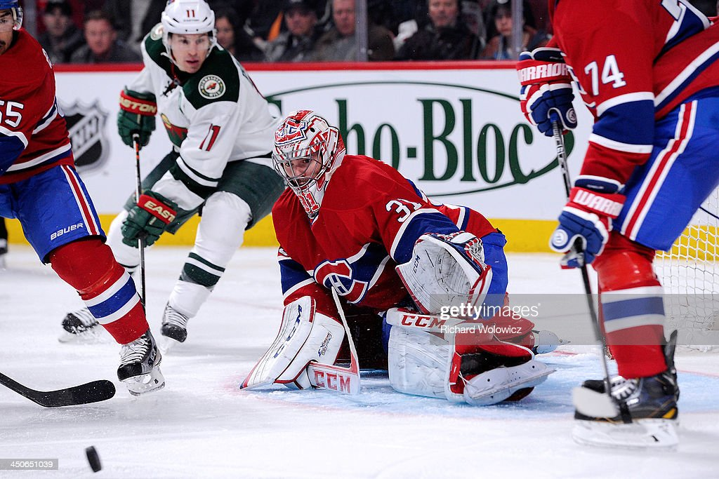 Goalie <a gi-track='captionPersonalityLinkClicked' href=/galleries/search?phrase=Carey+Price&family=editorial&specificpeople=2222083 ng-click='$event.stopPropagation()'>Carey Price</a> #31 of the Montreal Canadiens watches the rebounding puck during the NHL game against the Minnesota Wild at the Bell Centre on November 19, 2013 in Montreal, Quebec, Canada. The Canadiens defeated the Wild 6-2.