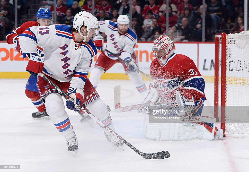 Goalie <a gi-track='captionPersonalityLinkClicked' href=/galleries/search?phrase=Carey+Price&family=editorial&specificpeople=2222083 ng-click='$event.stopPropagation()'>Carey Price</a> #31of the Montreal Canadiens blocks the shot by <a gi-track='captionPersonalityLinkClicked' href=/galleries/search?phrase=Daniel+Carcillo&family=editorial&specificpeople=2116181 ng-click='$event.stopPropagation()'>Daniel Carcillo</a> #13 of the New York Rangers during the NHL game on April 12, 2014 at the Bell Centre in Montreal, Quebec, Canada.