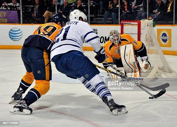 Goalie Carter Hutton of the Nashville Predators lines up to make a save on a shot by James van Riemsdyk of the Toronto Maple Leafs during the second...