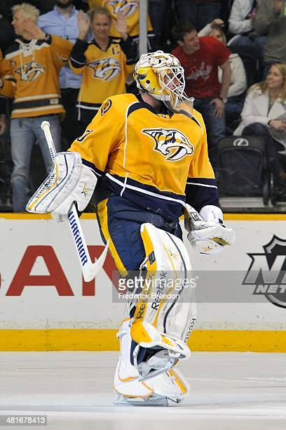 Goalie Carter Hutton of the Nashville Predators reacts after a victor against the Washington Capitals in a shootout at Bridgestone Arena on March 30...
