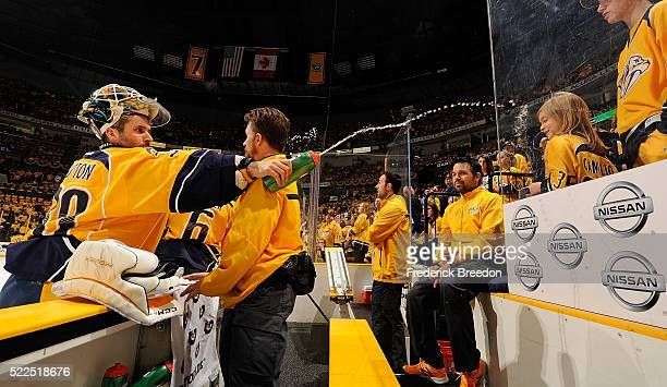 Goalie Carter Hutton of the Nashville Predators sprays water on a little girl prior to Game Three of the Western Conference First Round during the...