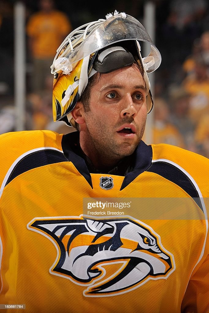 Goalie <a gi-track='captionPersonalityLinkClicked' href=/galleries/search?phrase=Carter+Hutton&family=editorial&specificpeople=6872781 ng-click='$event.stopPropagation()'>Carter Hutton</a> #30 of the Nashville Predators warms up prior to a game against the Minnesota Wild at Bridgestone Arena on October 8, 2013 in Nashville, Tennessee.