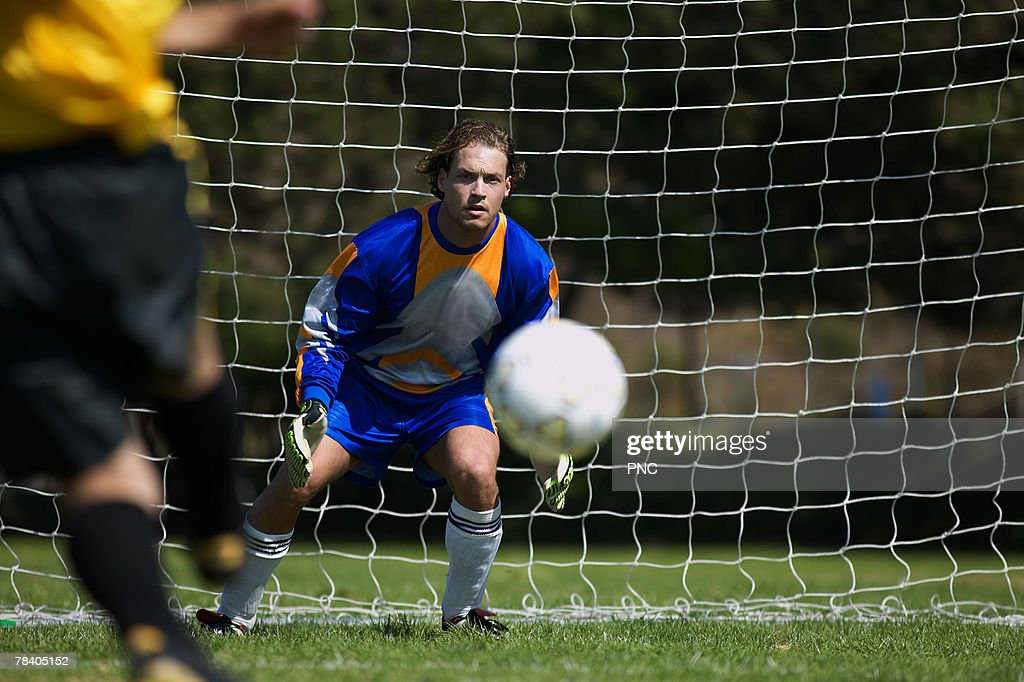 Goalie catching ball : Stock Photo