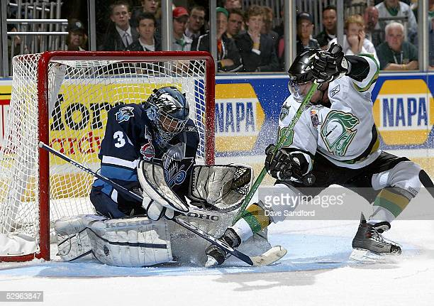 Goalie Cedrick Desjardins of the Rimouski Oceanic stops the puck against Dan Fritsche of the London Knights during the Memorial Cup Tournament at the...