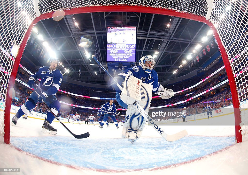 Goalie <a gi-track='captionPersonalityLinkClicked' href=/galleries/search?phrase=Cedrick+Desjardins&family=editorial&specificpeople=607111 ng-click='$event.stopPropagation()'>Cedrick Desjardins</a> #30 of the Tampa Bay Lightning defends the goal during the first period of the game against the Montreal Canadiens at the Tampa Bay Times Forum on March 9, 2013 in Tampa, Florida.