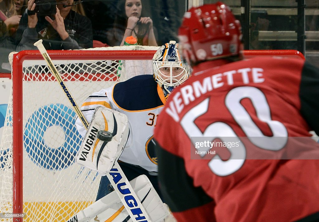 Goalie Chad Johnson #31 of the Buffalo Sabres looks to make a save on the shot by Antoine Vermette #50 of the Arizona Coyotes during the third period at Gila River Arena on January 18, 2016 in Glendale, Arizona.