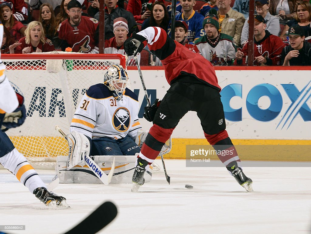 Goalie Chad Johnson #31 of the Buffalo Sabres makes a pad save on the shot by Viktor Tikhonov #9 of the Arizona Coyotes during the second period at Gila River Arena on January 18, 2016 in Glendale, Arizona.