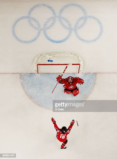 Goalie Charline Labonte and Danielle Goyette both of Canada celebrate their 41 victory over Sweden to win the gold medal in women's ice hockey during...