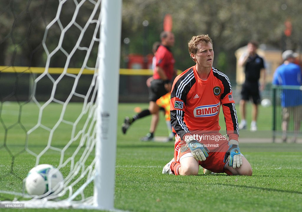 Goalie Chase Harrison #32 of the Philadelphia Union rdrops to his knees after a goal by the Columbus Crew February 13, 2013 in the second round of the Disney Pro Soccer Classic in Orlando, Florida.