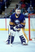 Goalie Clint Malarchuk of the Buffalo Sabres defends the net during an NHL game against the New York Islanders circa 1990 at the Nassau Coliseum in...
