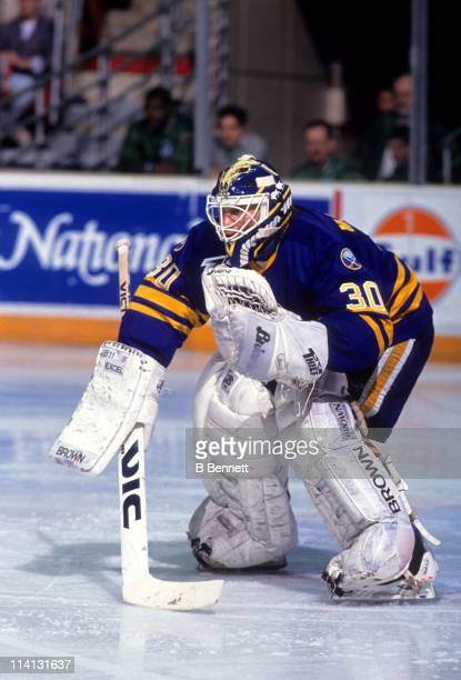 Goalie Clint Malarchuk of the Buffalo Sabres defends the net during an NHL game against the New York Islanders circa 1991 at the Nassau Coliseum in...