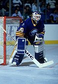 Goalie Clint Malarchuk of the Buffalo Sabres defends the net during an NHL game against the New York Islanders on October 20 1990 at the Nassau...