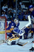 Goalie Clint Malarchuk of the Buffalo Sabres makes the save during an NHL game against the New York Islanders on October 20 1990 at the Nassau...