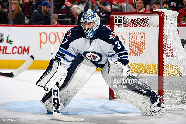 Goalie Connor Hellebuyck of the Winnipeg Jets guards the net in the first period against the Chicago Blackhawks at the United Center on December 4...