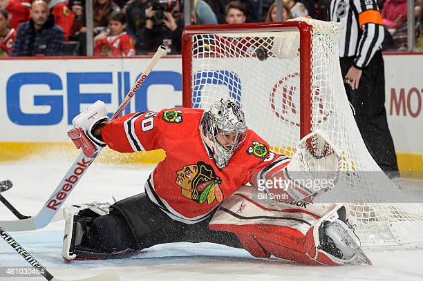 Goalie Corey Crawford of the Chicago Blackhawks attempts to stop the puck that results in a goal for the Dallas Stars in the second period during the...