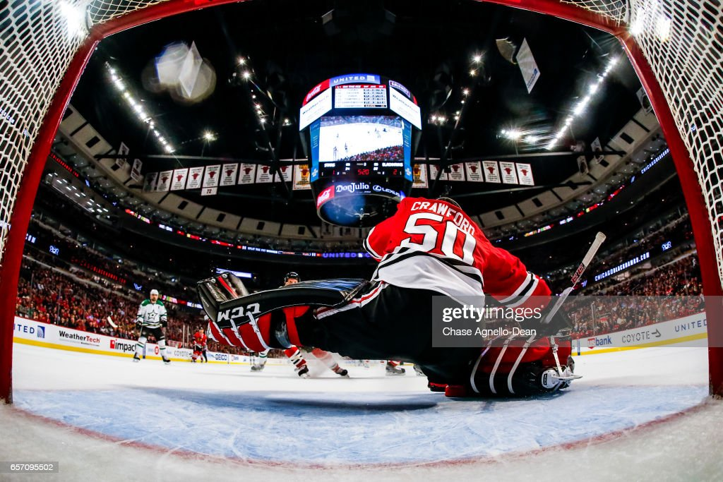 Goalie Corey Crawford #50 of the Chicago Blackhawks blocks a shot against the Dallas Stars in the third period at the United Center on March 23, 2017 in Chicago, Illinois.