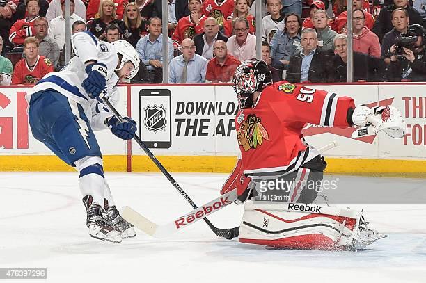 Goalie Corey Crawford of the Chicago Blackhawks blocks the shot taken by Nikita Kucherov of the Tampa Bay Lightning during Game Three of the 2015 NHL...