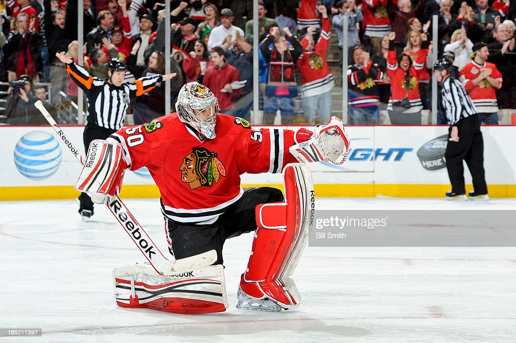 Goalie <a gi-track='captionPersonalityLinkClicked' href=/galleries/search?phrase=Corey+Crawford&family=editorial&specificpeople=818935 ng-click='$event.stopPropagation()'>Corey Crawford</a> #50 of the Chicago Blackhawks celebrates after the Blackhawks defeated the Nashville Predators 3-2 during the NHL game on April 01, 2013 at the United Center in Chicago, Illinois.