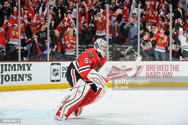 Goalie Corey Crawford of the Chicago Blackhawks celebrates after the Blackhawks defeated the Pittsburgh Penguins 21 during the NHL game at the United...