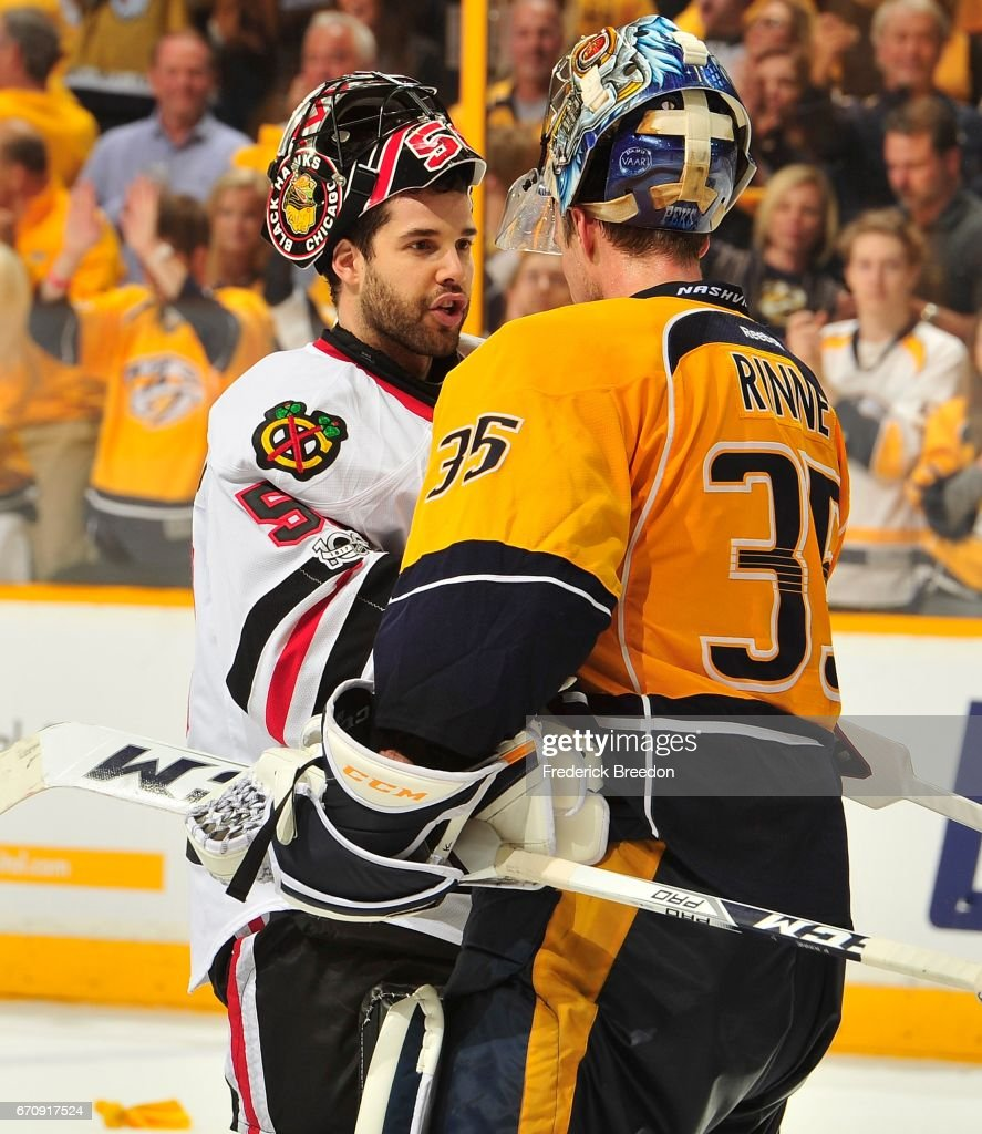 Goalie Corey Crawford #50 of the Chicago Blackhawks congratulates goalie Pekka Rinne #35 of the Nashville Predators after a 4-1 Predator vicoty in Game Four of the Western Conference First Round during the 2017 NHL Stanley Cup Playoffs at Bridgestone Arena on April 20, 2017 in Nashville, Tennessee.