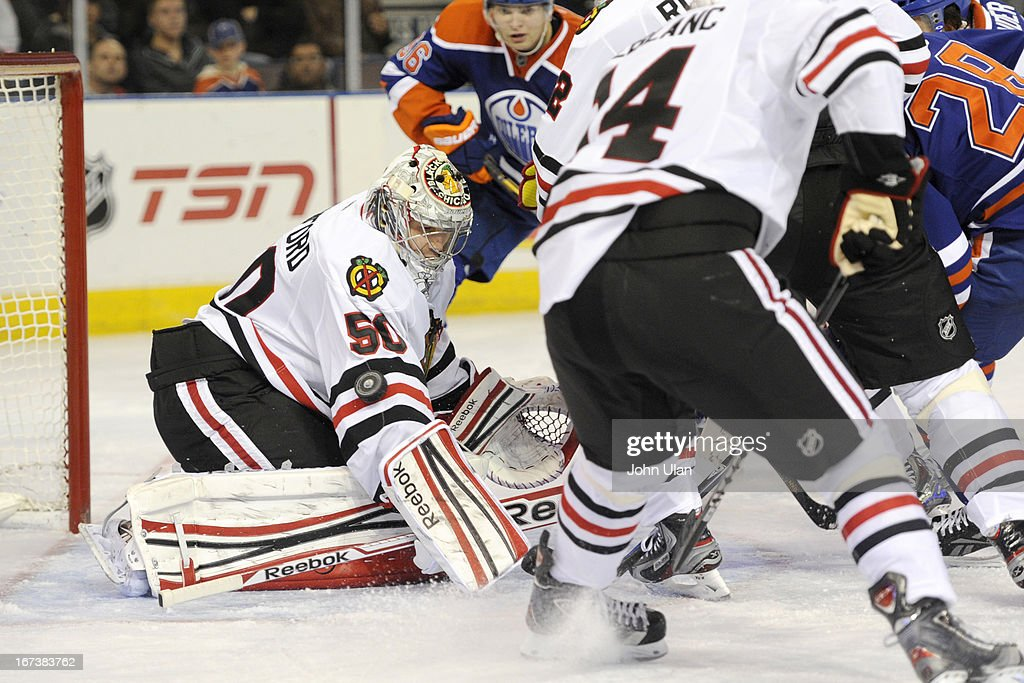 Goalie <a gi-track='captionPersonalityLinkClicked' href=/galleries/search?phrase=Corey+Crawford&family=editorial&specificpeople=818935 ng-click='$event.stopPropagation()'>Corey Crawford</a> #50 of the Chicago Blackhawks deflects a shot from the Edmonton Oilers on April 24, 2013 at Rexall Place in Edmonton, Alberta, Canada.