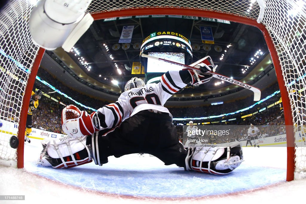 Goalie <a gi-track='captionPersonalityLinkClicked' href=/galleries/search?phrase=Corey+Crawford&family=editorial&specificpeople=818935 ng-click='$event.stopPropagation()'>Corey Crawford</a> #50 of the Chicago Blackhawks gives up a first period goal to Chris Kelly #23 of the Boston Bruins in Game Six of the 2013 NHL Stanley Cup Final at TD Garden on June 24, 2013 in Boston, Massachusetts.