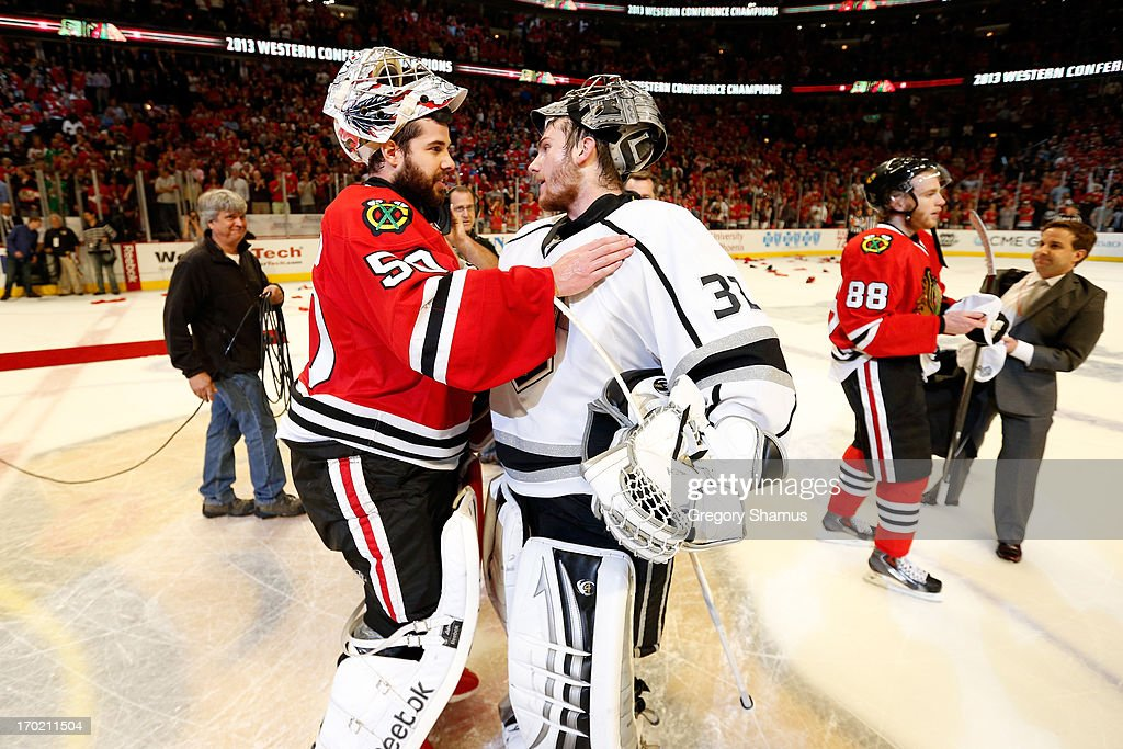 Goalie <a gi-track='captionPersonalityLinkClicked' href=/galleries/search?phrase=Corey+Crawford&family=editorial&specificpeople=818935 ng-click='$event.stopPropagation()'>Corey Crawford</a> #50 of the Chicago Blackhawks is congratulated by goalie <a gi-track='captionPersonalityLinkClicked' href=/galleries/search?phrase=Jonathan+Quick&family=editorial&specificpeople=2271852 ng-click='$event.stopPropagation()'>Jonathan Quick</a> #32 of the Los Angeles Kings after the Blackhawks won 4-3 in the second overtime during Game Five of the Western Conference Finals of the 2013 NHL Stanley Cup Playoffs at United Center on June 8, 2013 in Chicago, Illinois.