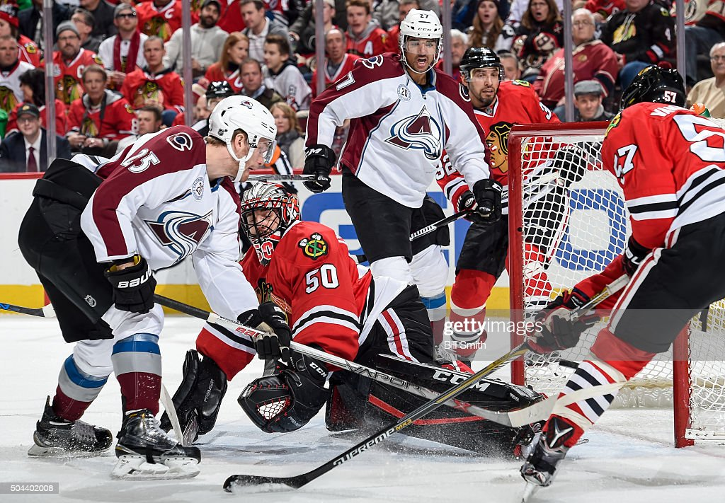 Goalie <a gi-track='captionPersonalityLinkClicked' href=/galleries/search?phrase=Corey+Crawford&family=editorial&specificpeople=818935 ng-click='$event.stopPropagation()'>Corey Crawford</a> #50 of the Chicago Blackhawks is scored on as <a gi-track='captionPersonalityLinkClicked' href=/galleries/search?phrase=Mikhail+Grigorenko&family=editorial&specificpeople=8771251 ng-click='$event.stopPropagation()'>Mikhail Grigorenko</a> #25 of the Colorado Avalanche rushes in, and <a gi-track='captionPersonalityLinkClicked' href=/galleries/search?phrase=Andreas+Martinsen+-+Ice+Hockey+Player&family=editorial&specificpeople=14603787 ng-click='$event.stopPropagation()'>Andreas Martinsen</a> #27 and <a gi-track='captionPersonalityLinkClicked' href=/galleries/search?phrase=Michal+Rozsival&family=editorial&specificpeople=216462 ng-click='$event.stopPropagation()'>Michal Rozsival</a> #32 watch in the background, in the second period of the NHL game at the United Center on January 10, 2016 in Chicago, Illinois.
