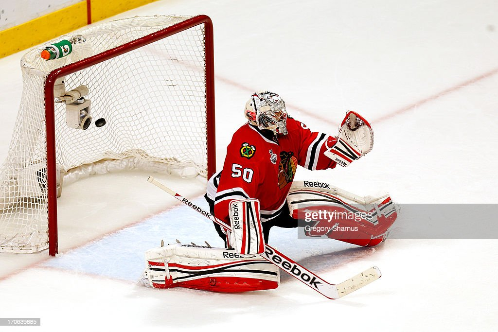 Goalie <a gi-track='captionPersonalityLinkClicked' href=/galleries/search?phrase=Corey+Crawford&family=editorial&specificpeople=818935 ng-click='$event.stopPropagation()'>Corey Crawford</a> #50 of the Chicago Blackhawks lets in the game-winning goal in the first overtime off of the stick of <a gi-track='captionPersonalityLinkClicked' href=/galleries/search?phrase=Daniel+Paille&family=editorial&specificpeople=706561 ng-click='$event.stopPropagation()'>Daniel Paille</a> #20 of the Boston Bruins in Game Two of the NHL 2013 Stanley Cup Final at United Center on June 15, 2013 in Chicago, Illinois.