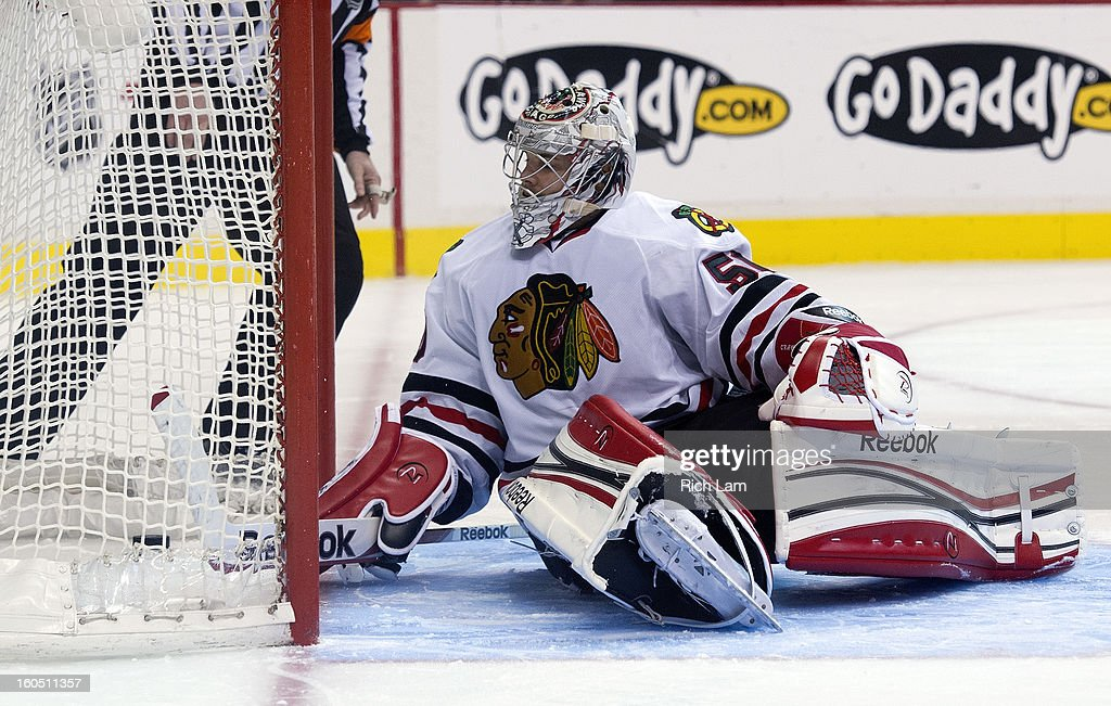 Goalie <a gi-track='captionPersonalityLinkClicked' href=/galleries/search?phrase=Corey+Crawford&family=editorial&specificpeople=818935 ng-click='$event.stopPropagation()'>Corey Crawford</a> #50 of the Chicago Blackhawks looks back into his net after getting scored on by Jordan Schroeder #45 of the Vancouver Canucks during shootout in NHL action on February 1, 2013 at Rogers Arena in Vancouver, British Columbia, Canada. The Canucks defeated the Blackhawks 2-1.
