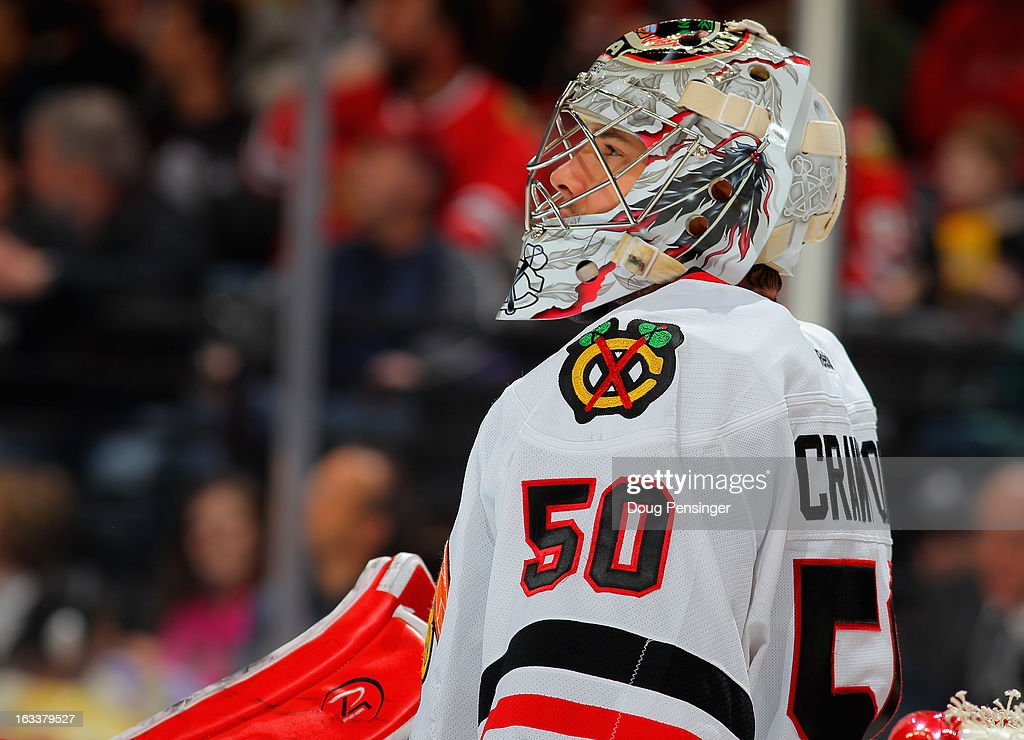 Goalie Corey Crawford #50 of the Chicago Blackhawks looks on during a break in the action against the Colorado Avalanche at the Pepsi Center on March 8, 2013 in Denver, Colorado.
