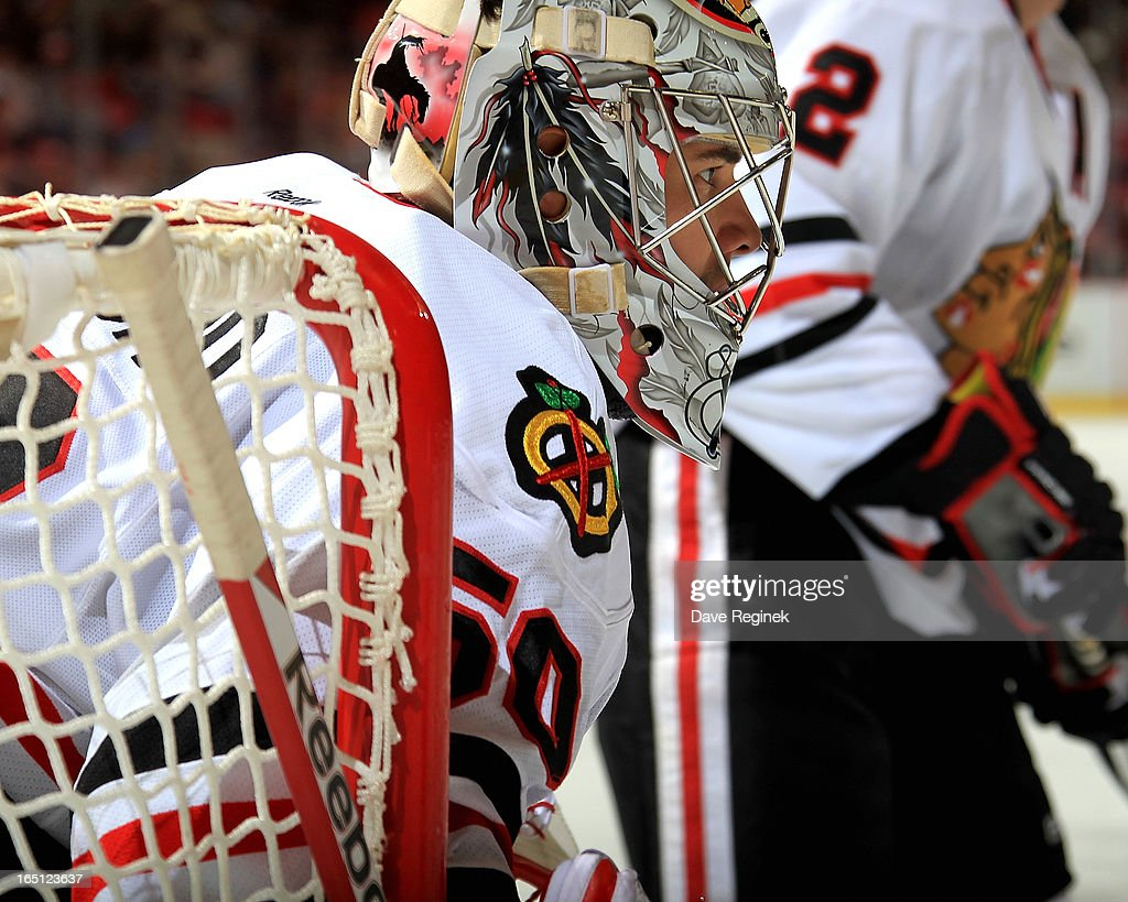Goalie Corey Crawford #50 of the Chicago Blackhawks looks over to the face off circle during a NHL game against the Detroit Red Wings at Joe Louis Arena on March 31, 2013 in Detroit, Michigan. Chicago defeated Detroit 7-1