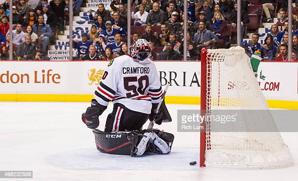 Goalie Corey Crawford of the Chicago Blackhawks reacts after getting scored on by Daniel Sedin of the Vancouver Canucks in NHL action on November...