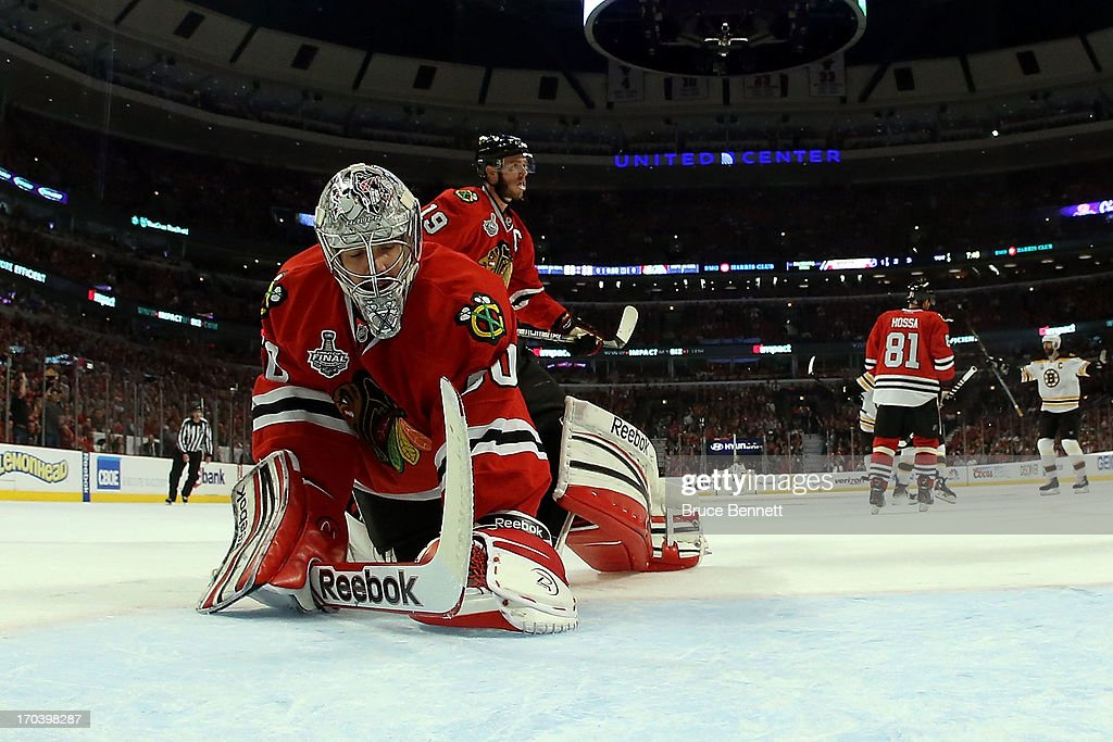 Goalie <a gi-track='captionPersonalityLinkClicked' href=/galleries/search?phrase=Corey+Crawford&family=editorial&specificpeople=818935 ng-click='$event.stopPropagation()'>Corey Crawford</a> #50 of the Chicago Blackhawks reacts after he gave up a goal in the first period to Milan Lucic #17 (not pictured) of the Boston Bruins in Game One of the 2013 NHL Stanley Cup Final at United Center on June 12, 2013 in Chicago, Illinois.