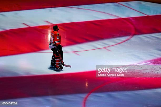 Goalie Corey Crawford of the Chicago Blackhawks stands on the ice during the national anthem prior to the start of the NHL game against the Montreal...