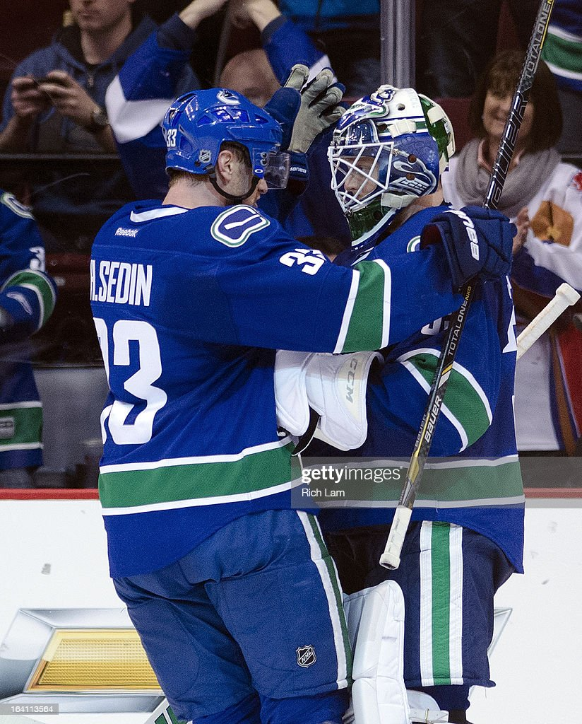 Goalie Cory Schneider #35 of the Vancouver Canucks is congratulated by teammate Henrik Sedin #33 after defeating the St. Louis Blues 3-2 in NHL action on March 19, 2013 at Rogers Arena in Vancouver, British Columbia, Canada.