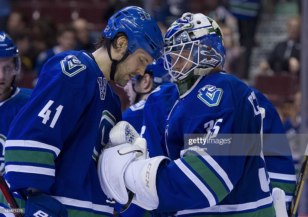 Goalie <a gi-track='captionPersonalityLinkClicked' href=/galleries/search?phrase=Cory+Schneider&family=editorial&specificpeople=696908 ng-click='$event.stopPropagation()'>Cory Schneider</a> #35 of the Vancouver Canucks is congratulated by teammate <a gi-track='captionPersonalityLinkClicked' href=/galleries/search?phrase=Andrew+Alberts&family=editorial&specificpeople=622259 ng-click='$event.stopPropagation()'>Andrew Alberts</a> #41 after defeating the Colorado Avalanche 4-1 in NHL action on March 28, 2013 at Rogers Arena in Vancouver, British Columbia, Canada.