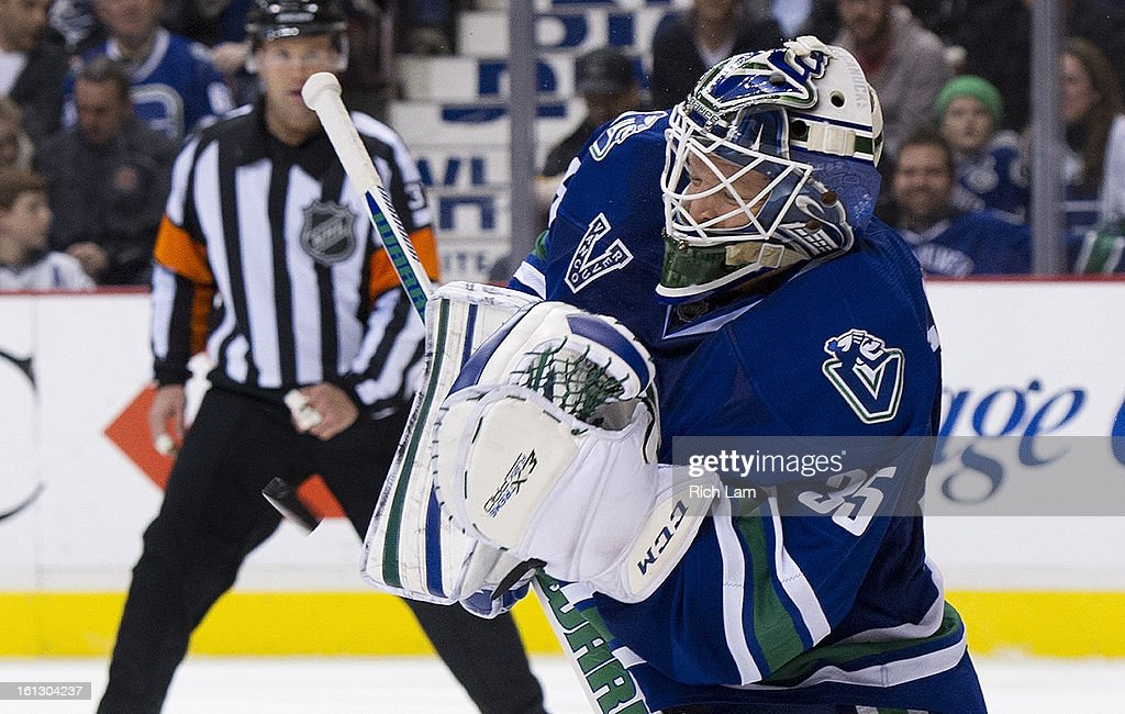 Goalie <a gi-track='captionPersonalityLinkClicked' href=/galleries/search?phrase=Cory+Schneider&family=editorial&specificpeople=696908 ng-click='$event.stopPropagation()'>Cory Schneider</a> #35 of the Vancouver Canucks makes a blocker save against the Calgary Flames during the third period in NHL action on February 09, 2013 at Rogers Arena in Vancouver, British Columbia, Canada.