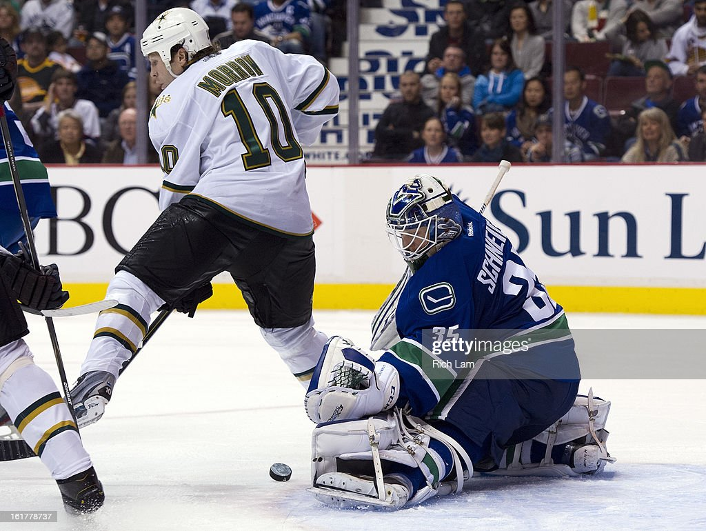 Goalie <a gi-track='captionPersonalityLinkClicked' href=/galleries/search?phrase=Cory+Schneider&family=editorial&specificpeople=696908 ng-click='$event.stopPropagation()'>Cory Schneider</a> #35 of the Vancouver Canucks makes a pad save while <a gi-track='captionPersonalityLinkClicked' href=/galleries/search?phrase=Brenden+Morrow&family=editorial&specificpeople=202256 ng-click='$event.stopPropagation()'>Brenden Morrow</a> #10 of the Dallas Stars tries to provide a screen during the third period in NHL action on February 15, 2013 at Rogers Arena in Vancouver, British Columbia, Canada.